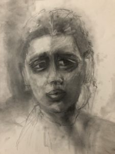Charcoal drawing of young woman